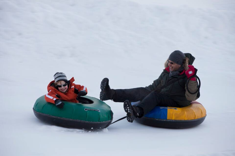 snow tubing winter holiday walchsee